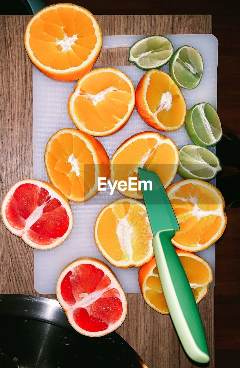 food and drink, food, healthy eating, fruit, orange color, citrus fruit, orange, orange - fruit, wellbeing, freshness, slice, table, cross section, still life, indoors, high angle view, no people, halved, blood orange, cutting board, ripe