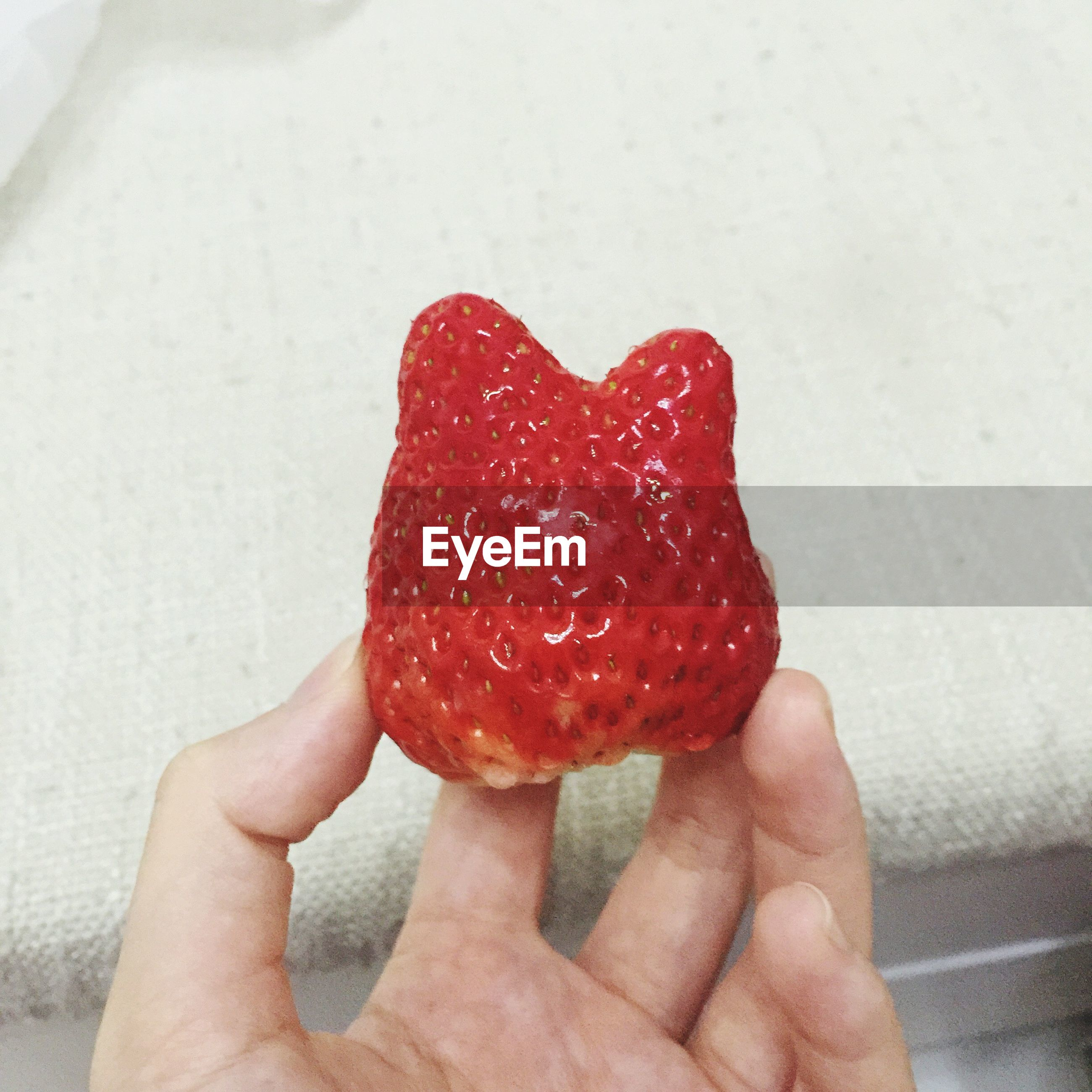food and drink, person, food, holding, freshness, red, fruit, strawberry, part of, sweet food, healthy eating, cropped, unrecognizable person, human finger, indulgence, close-up, personal perspective