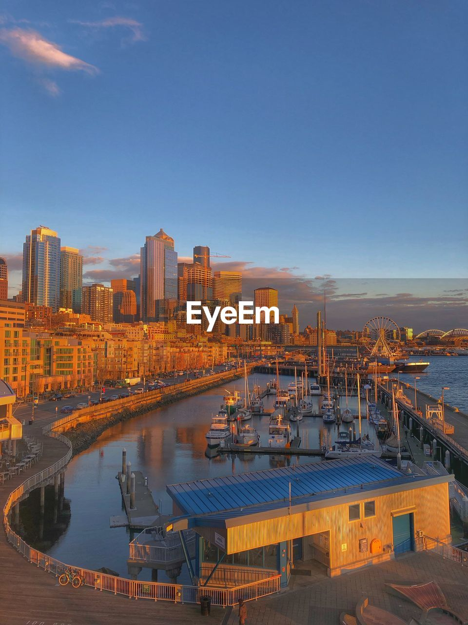 water, sky, architecture, building exterior, built structure, transportation, city, nature, reflection, river, no people, cityscape, high angle view, nautical vessel, building, outdoors, sunset, harbor, mode of transportation, office building exterior, skyscraper