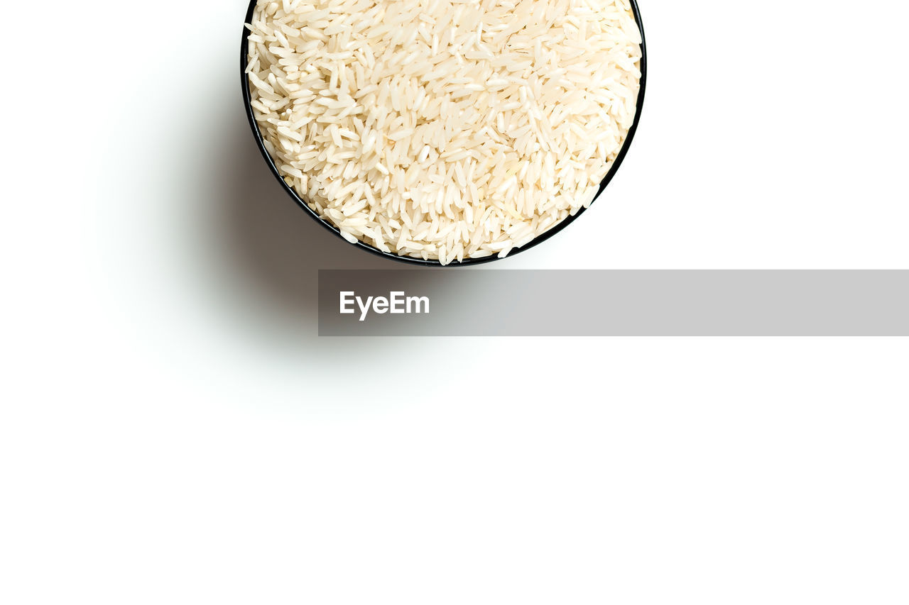 Directly Above Shot Of Rice In Bowl Against White Background
