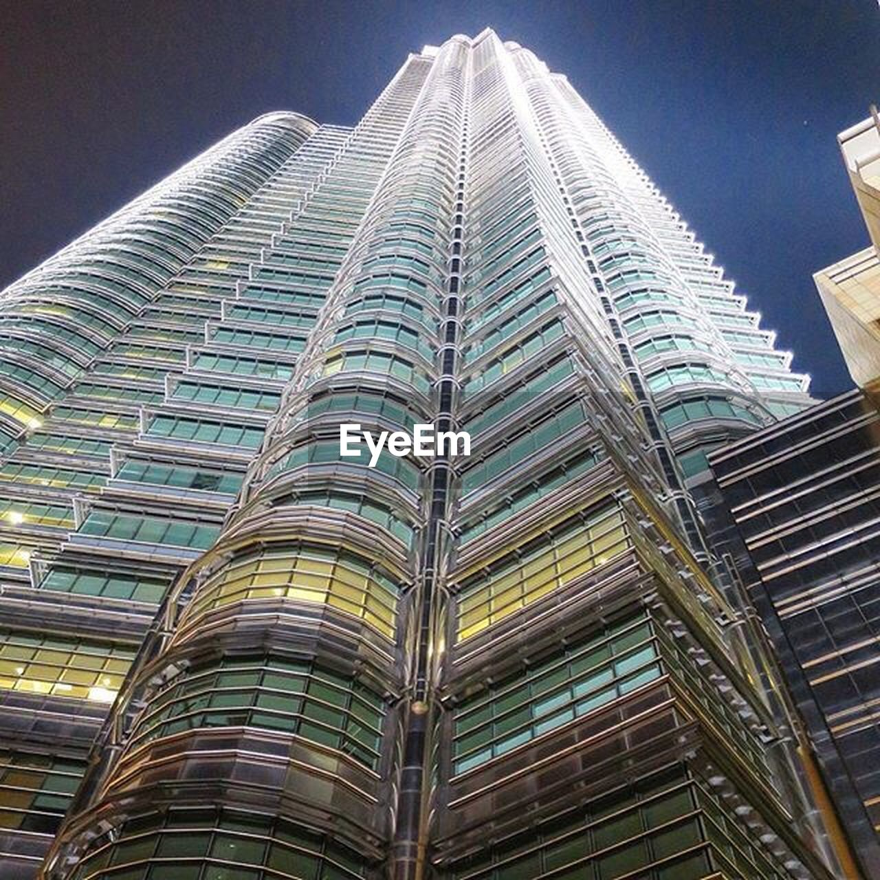 architecture, skyscraper, built structure, building exterior, tall - high, low angle view, modern, city, tower, outdoors, no people, travel destinations, day, sky