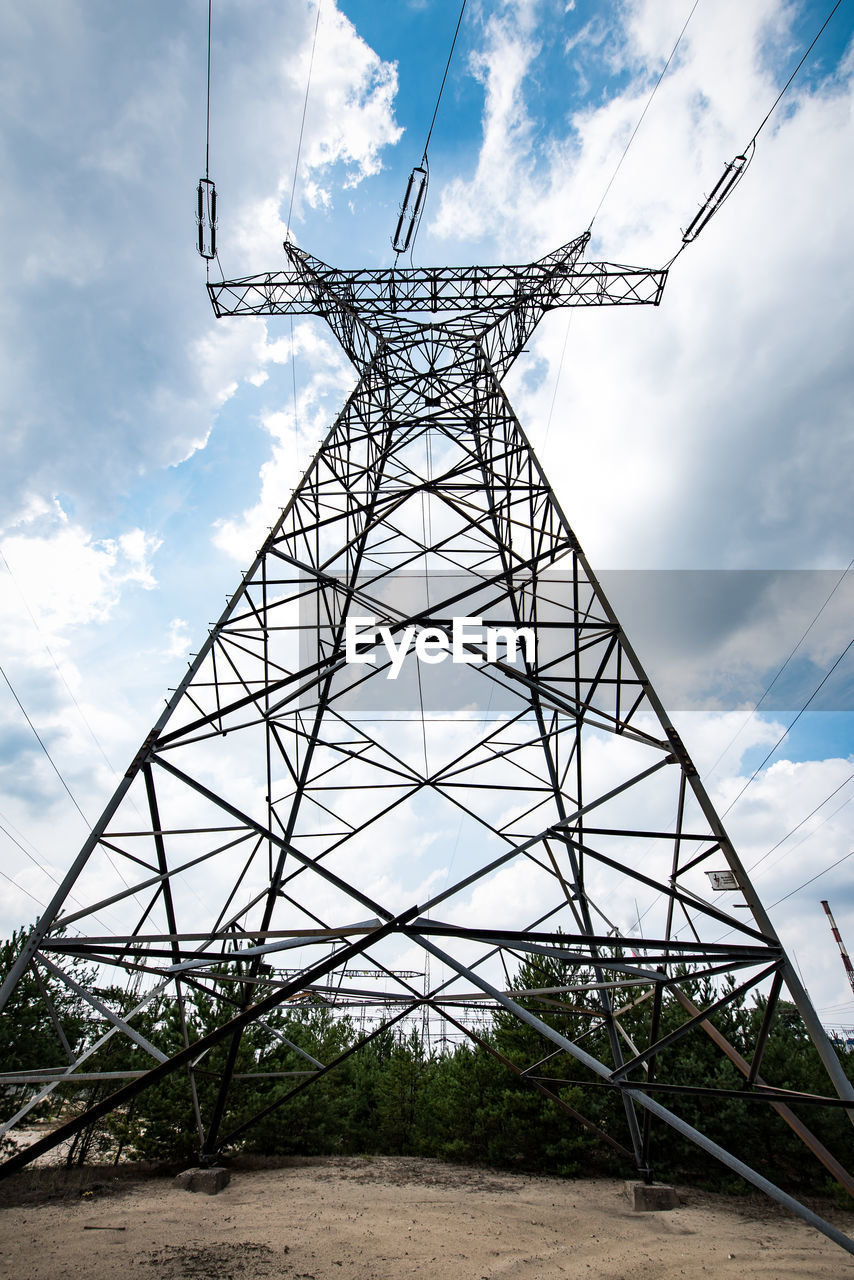 sky, cloud - sky, technology, nature, low angle view, connection, day, metal, no people, electricity pylon, built structure, fuel and power generation, architecture, electricity, outdoors, cable, power supply, land, power line, field, alloy, girder, electrical component