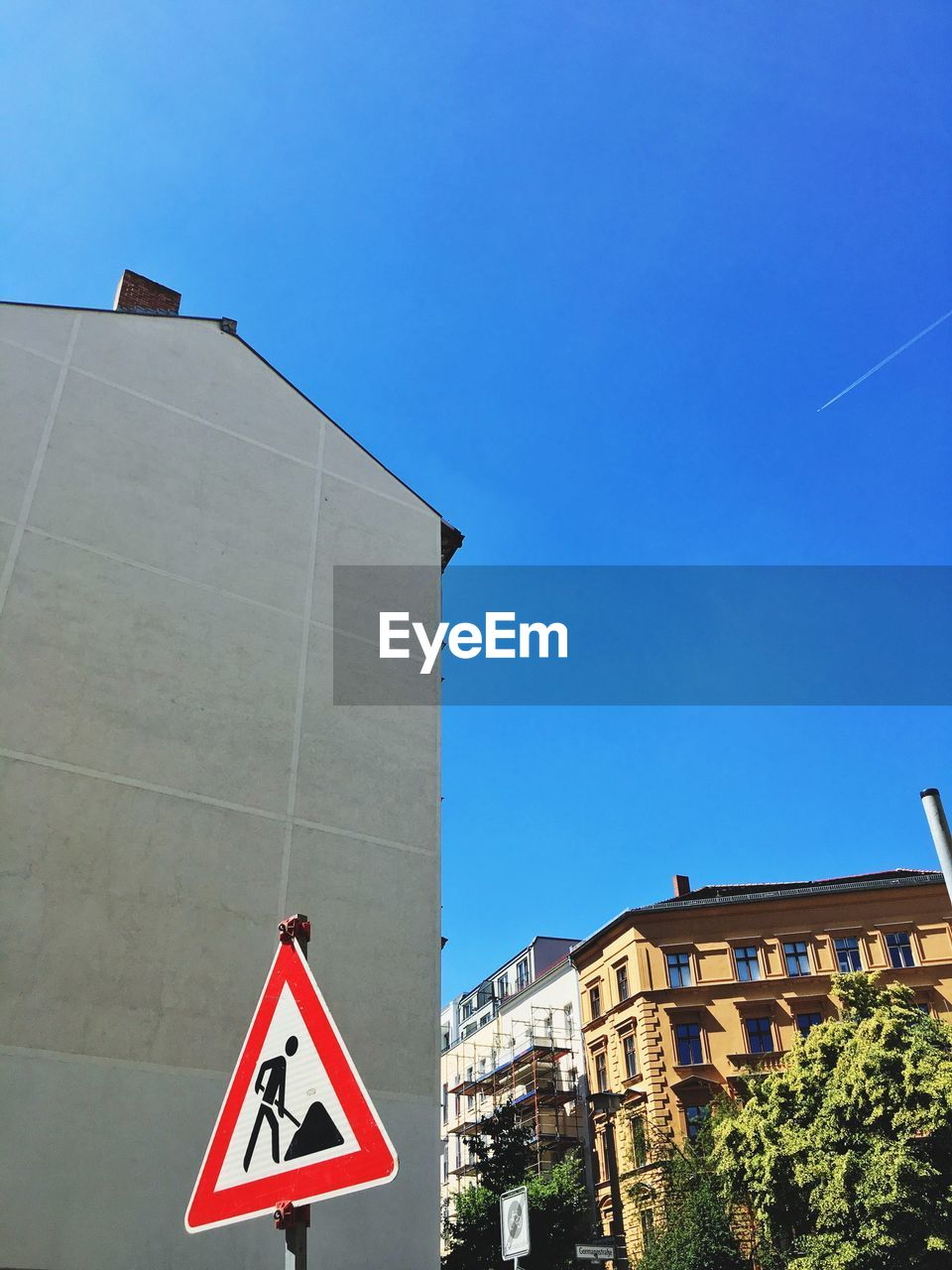 communication, road sign, architecture, built structure, guidance, day, outdoors, building exterior, low angle view, no people, clear sky, sky