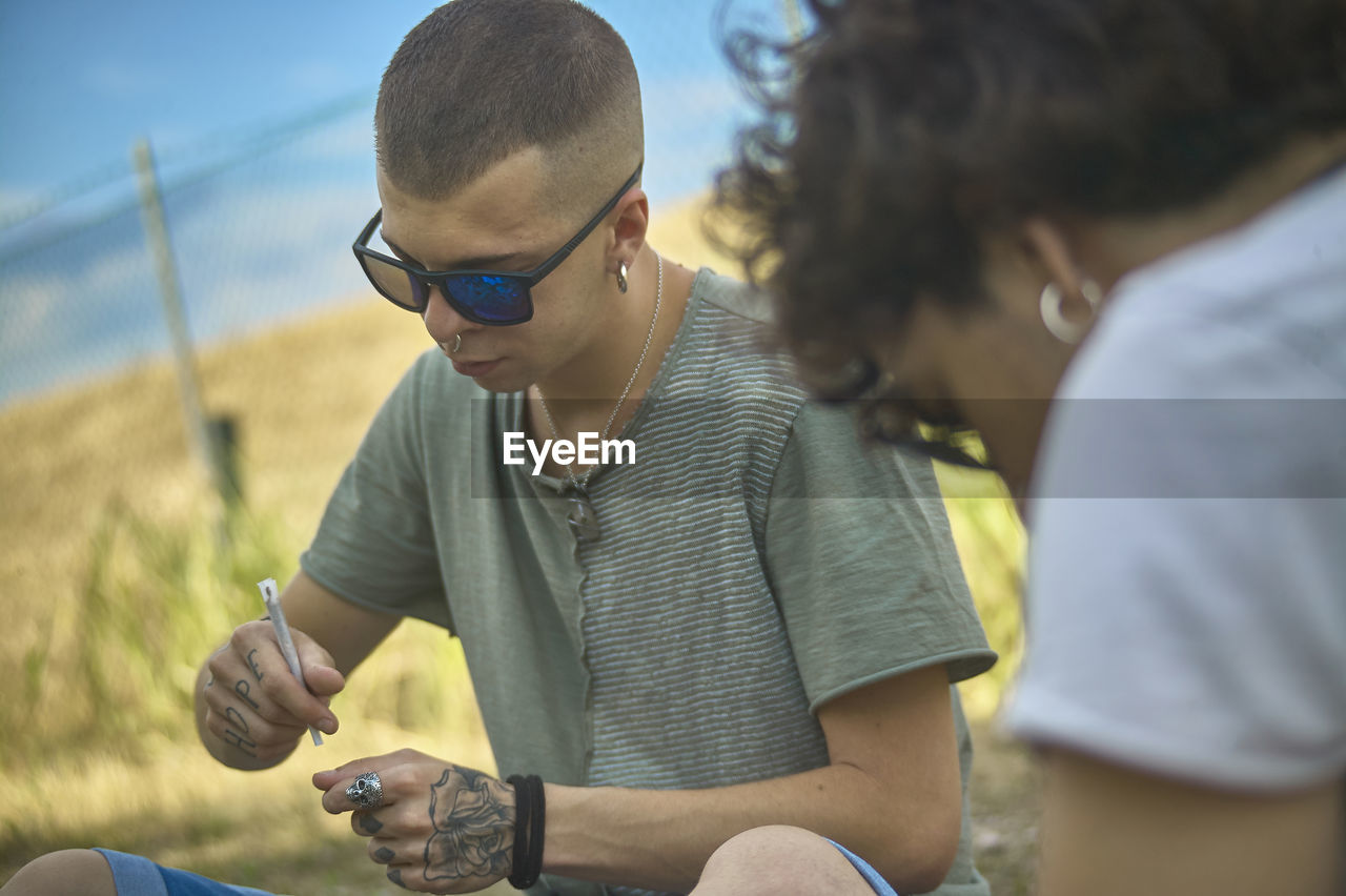 real people, men, child, males, leisure activity, lifestyles, boys, fashion, two people, sunglasses, casual clothing, childhood, glasses, people, three quarter length, focus on foreground, bonding, togetherness, holding, outdoors