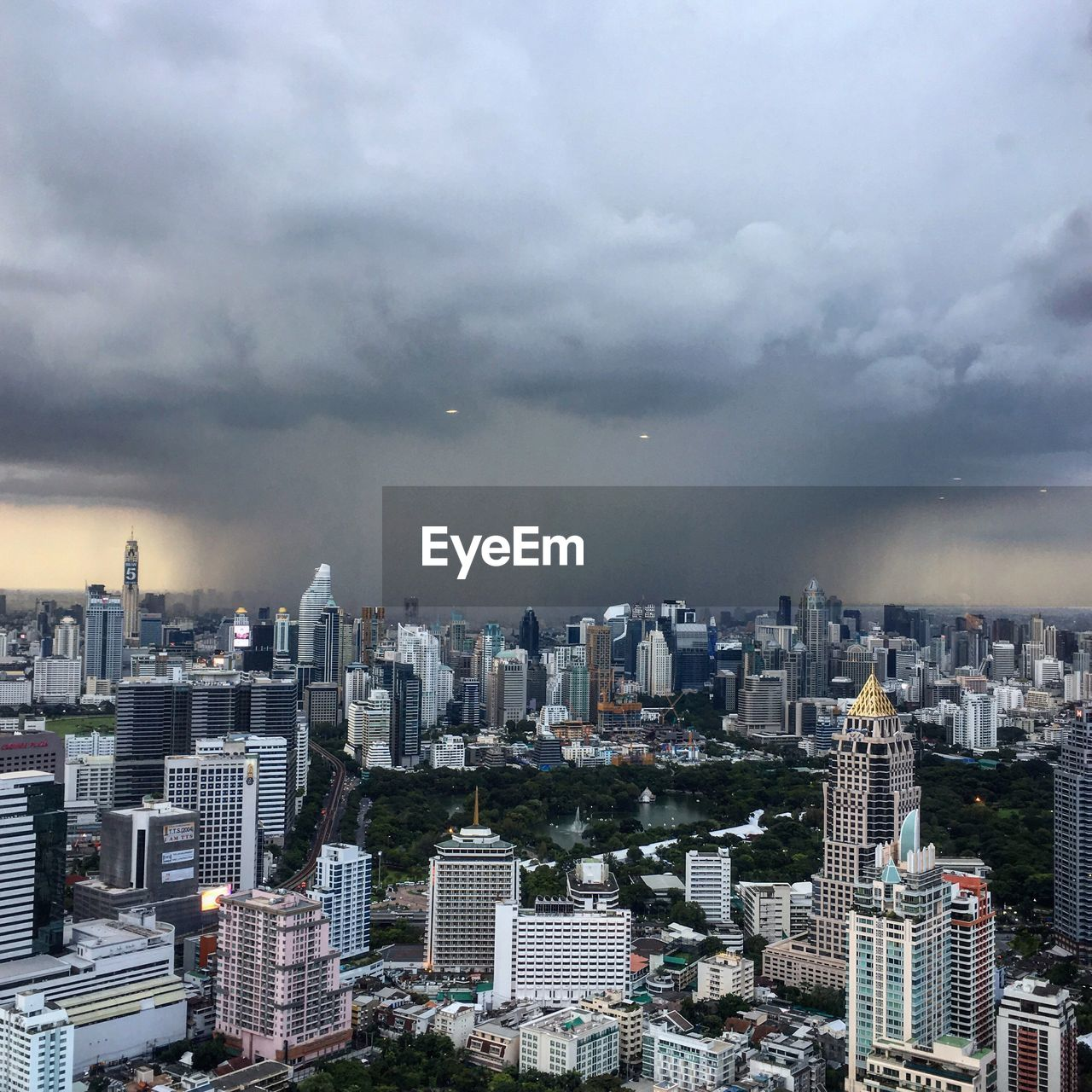 View Of City Against Cloudy Sky