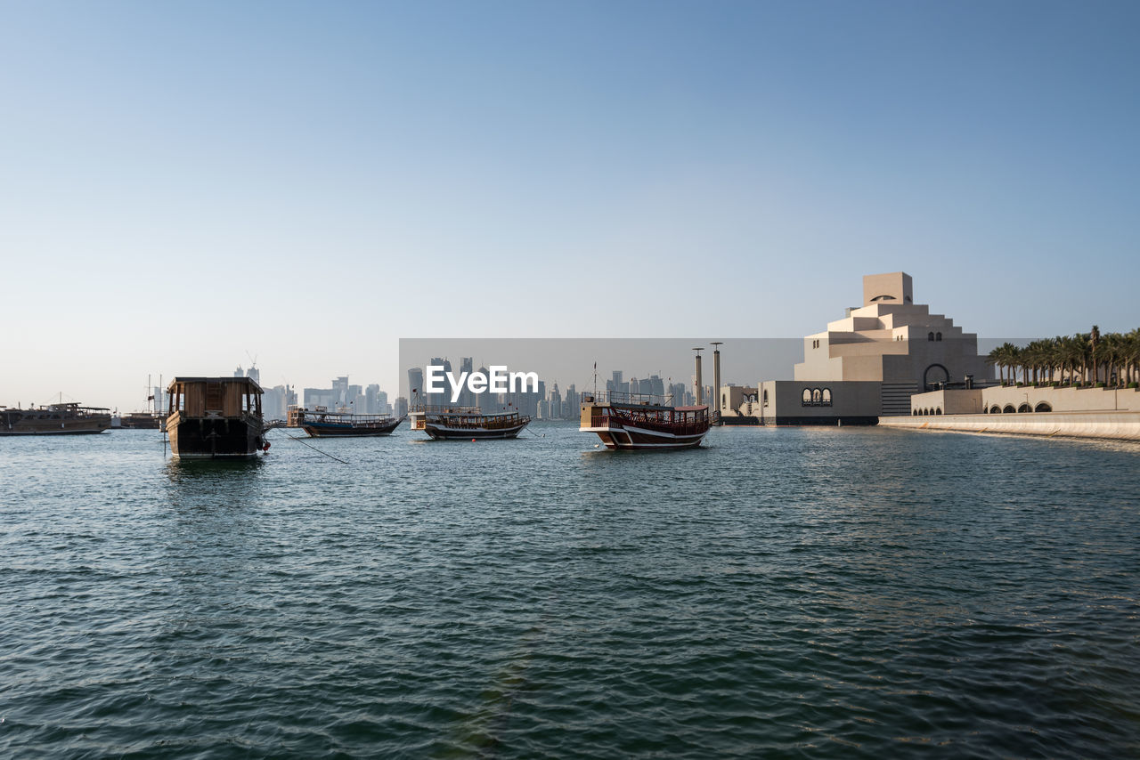 water, waterfront, sky, nautical vessel, transportation, mode of transportation, clear sky, copy space, sea, architecture, nature, no people, building exterior, day, built structure, outdoors, city, beauty in nature, ship, sailboat, passenger craft