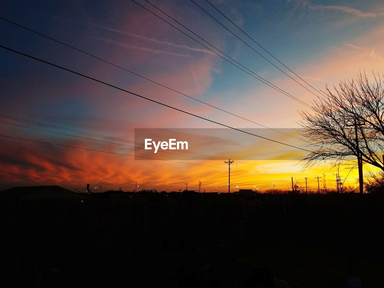 sky, sunset, silhouette, cable, electricity, orange color, beauty in nature, power line, cloud - sky, scenics - nature, technology, no people, landscape, tranquil scene, tranquility, nature, electricity pylon, environment, connection, power supply, outdoors