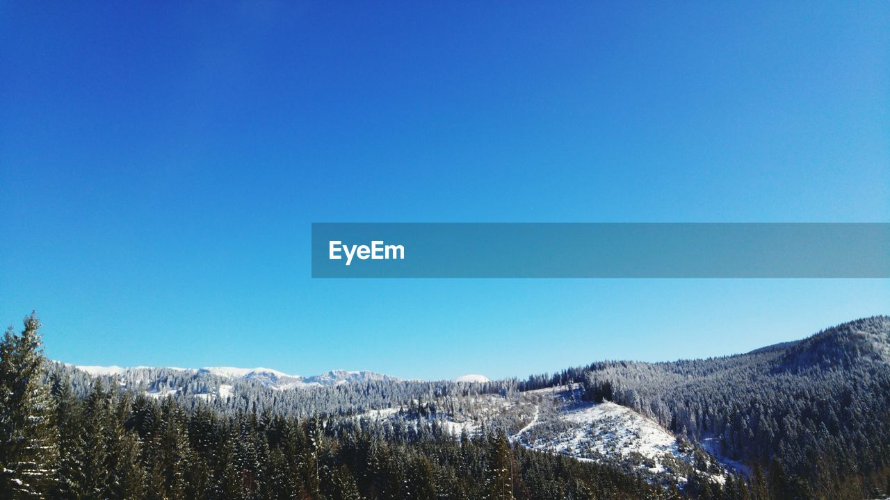 winter, cold temperature, snow, nature, blue, copy space, beauty in nature, clear sky, scenics, tranquility, tranquil scene, mountain, outdoors, day, landscape, weather, no people, frozen, tree, snowcapped mountain, mountain range, sky