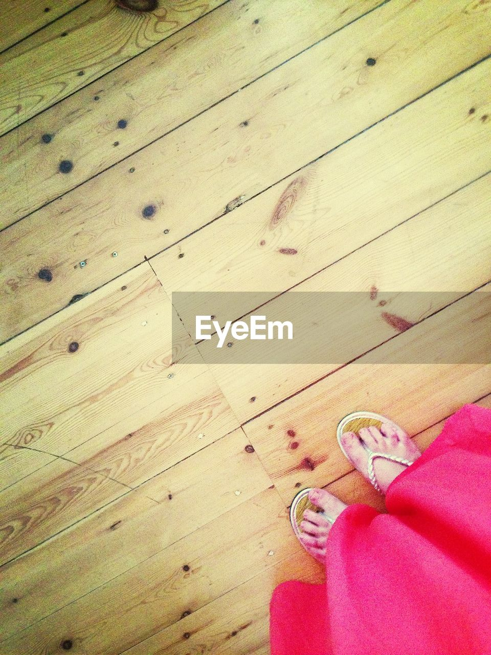 indoors, table, human body part, wood - material, one person, pair, hardwood floor, human hand, low section, close-up, real people, day, people