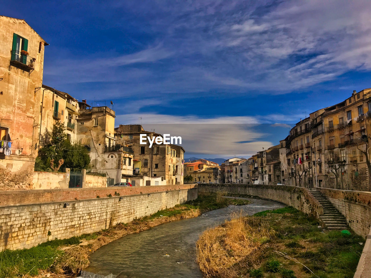 architecture, built structure, building exterior, sky, water, nature, cloud - sky, city, building, history, the past, no people, travel destinations, old, day, residential district, connection, wall, river, outdoors, ancient civilization