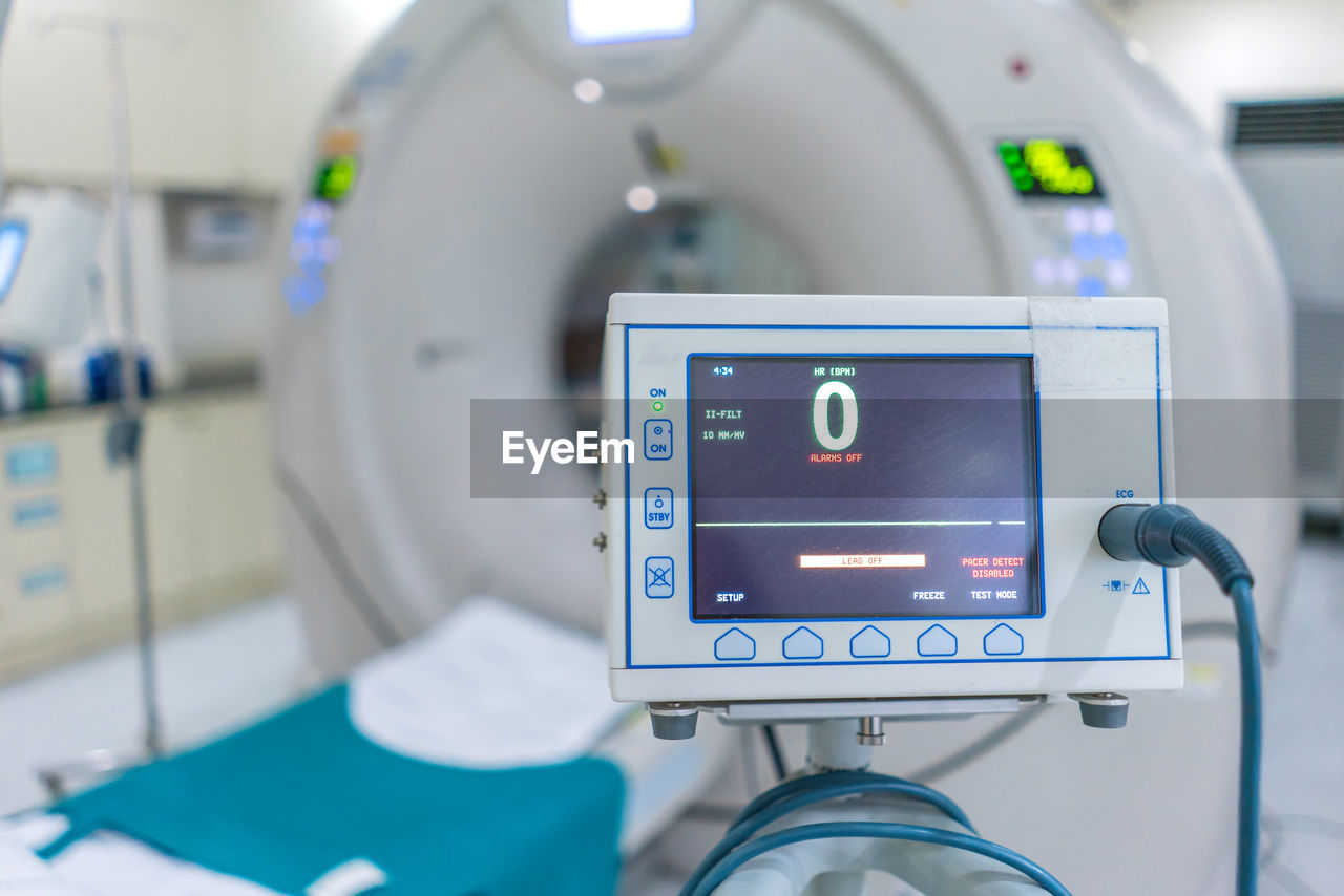technology, communication, focus on foreground, close-up, indoors, healthcare and medicine, one person, number, modern, real people, computer monitor, illuminated, text, device screen, equipment, hospital, digital display, connection, men