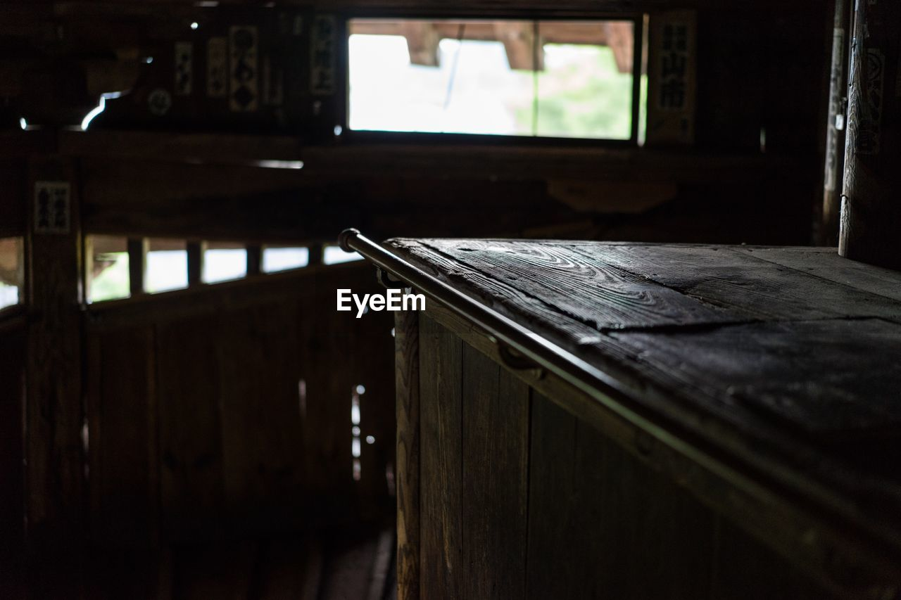 wood - material, indoors, table, selective focus, no people, focus on foreground, window, day, architecture, furniture, absence, seat, house, dark, empty, built structure, wood, old
