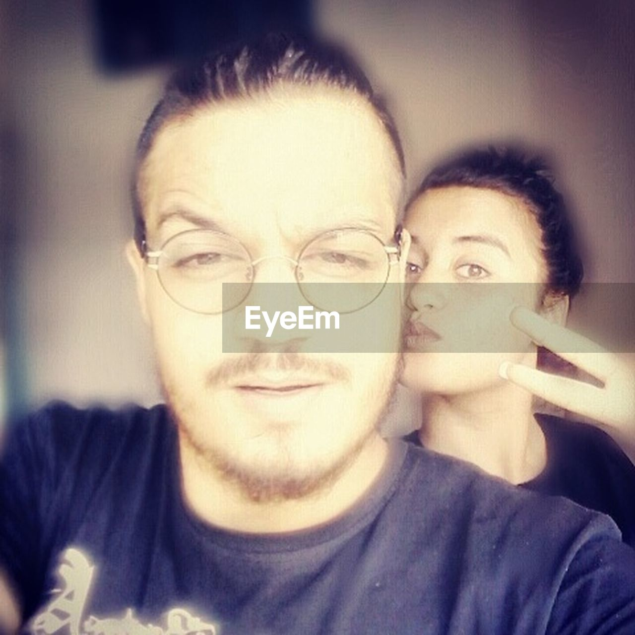 two people, looking at camera, eyeglasses, togetherness, portrait, young adult, real people, young women, young men, leisure activity, friendship, lifestyles, headshot, women, bonding, couple - relationship, close-up, indoors, men, adult, day, people, adults only