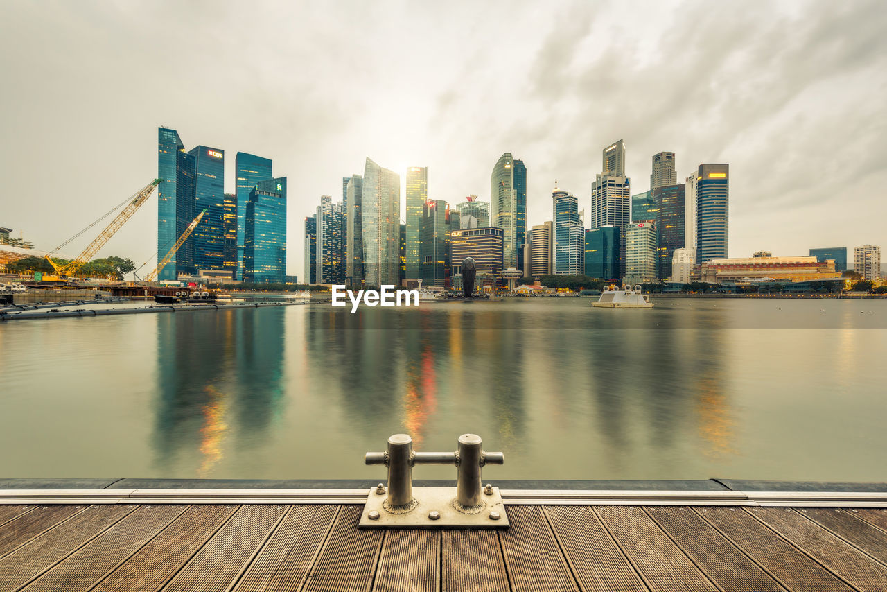 Modern Buildings By Bay Against Sky In City