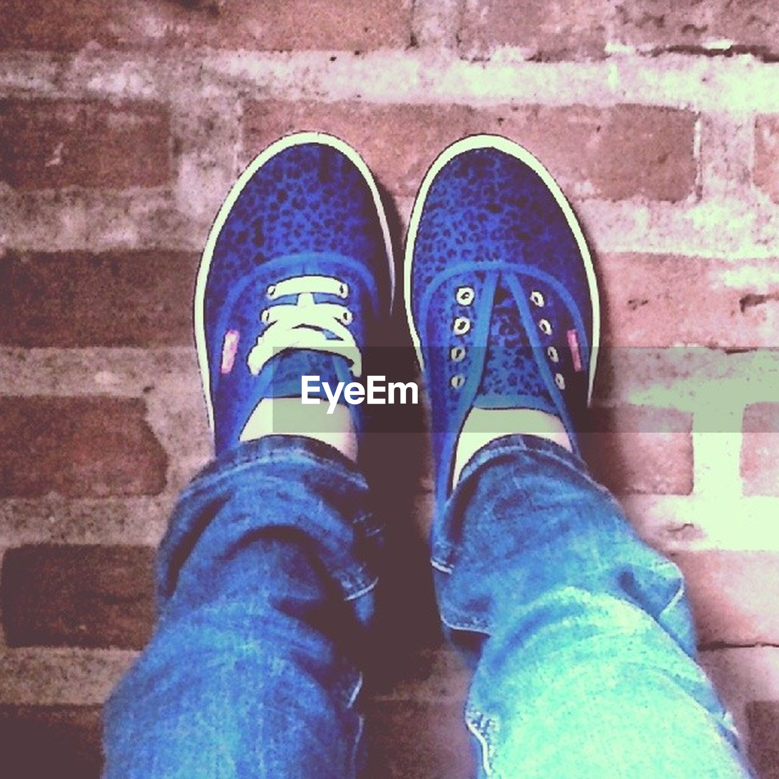 low section, person, shoe, personal perspective, jeans, human foot, footwear, lifestyles, standing, blue, men, leisure activity, directly above, high angle view, canvas shoe, part of, casual clothing