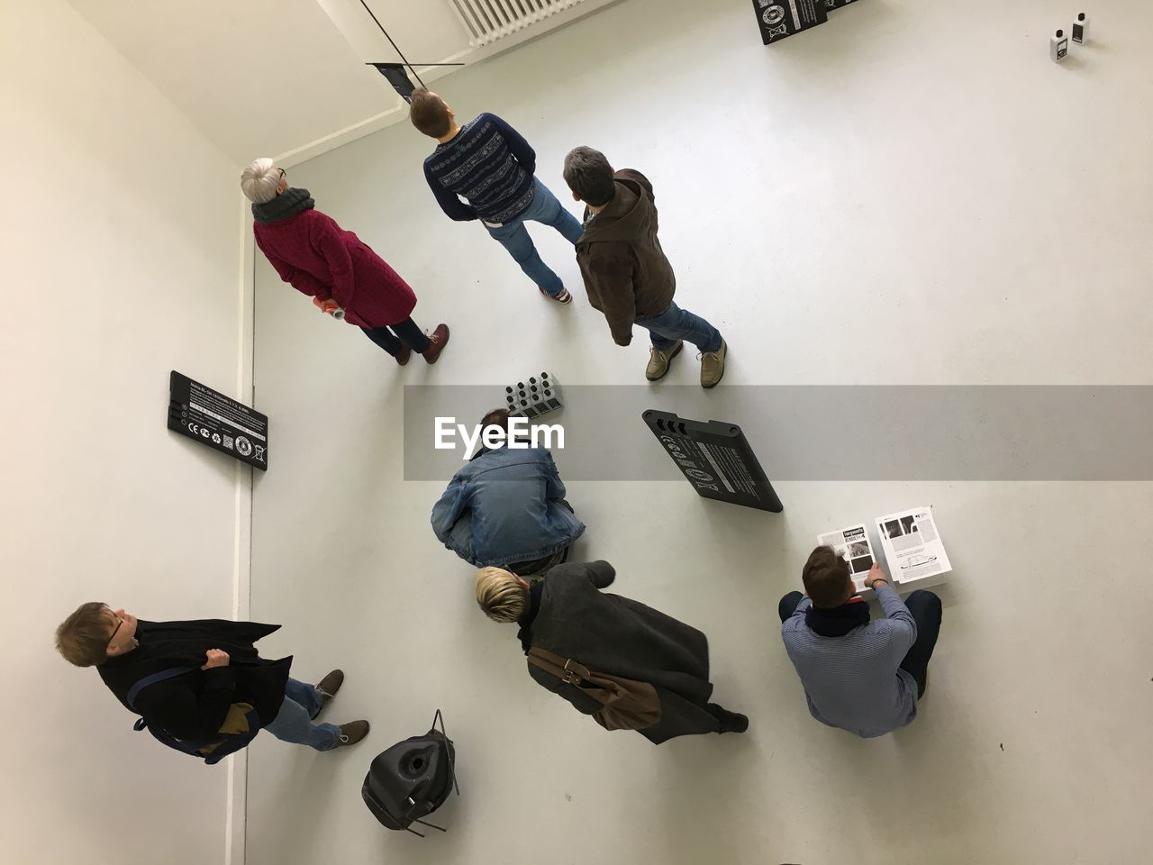 HIGH ANGLE VIEW OF MEN HANGING ON TEXT