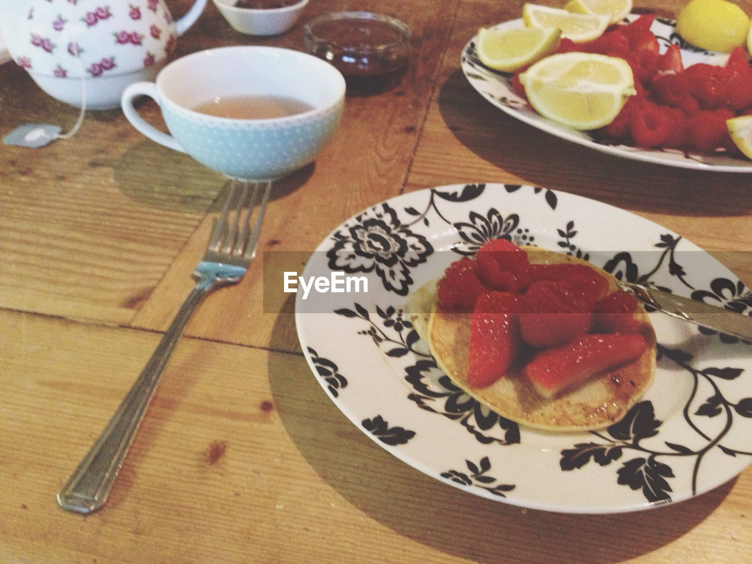 food and drink, food, freshness, indoors, table, plate, ready-to-eat, still life, healthy eating, serving size, high angle view, breakfast, fruit, indulgence, bowl, drink, strawberry, spoon, fork, slice