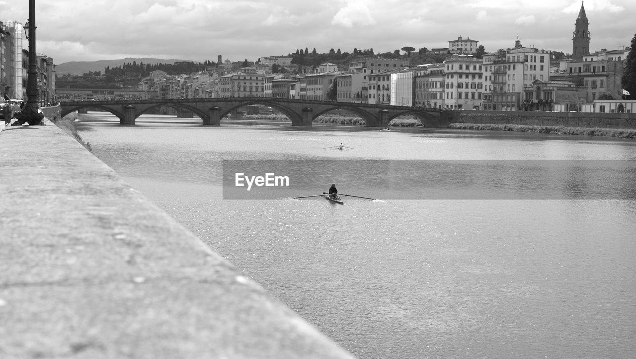 Bridge Over River In City Against