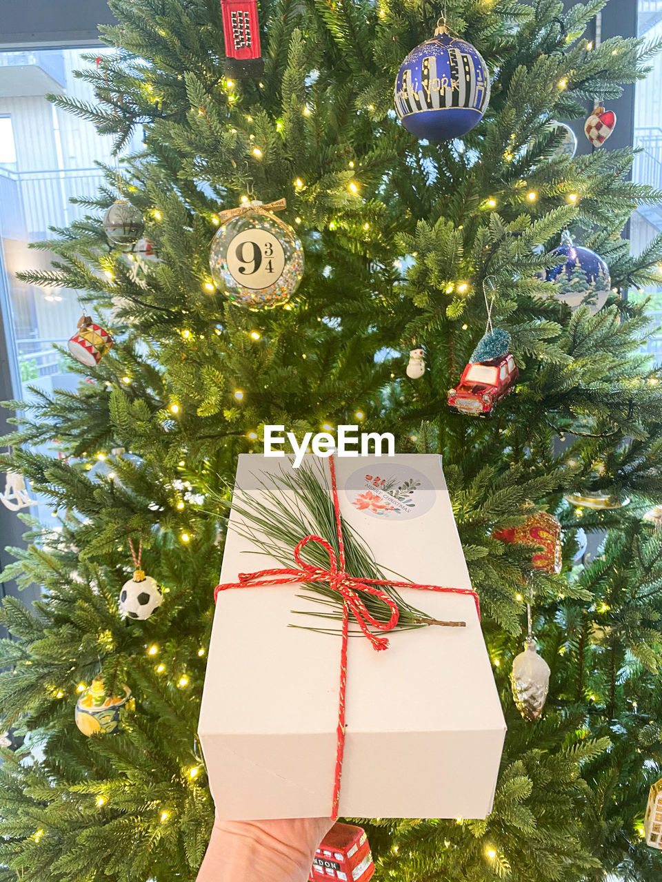 CHRISTMAS DECORATION HANGING ON TREE AT HOME