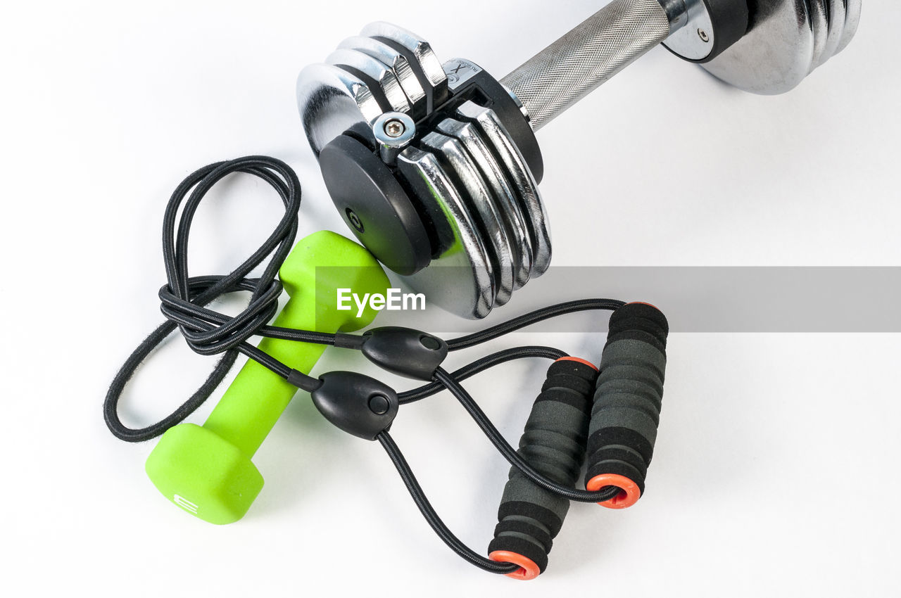 white background, indoors, studio shot, still life, no people, high angle view, close-up, table, metal, cable, directly above, black color, technology, equipment, kitchen utensil, group of objects, connection, green color, large group of objects, cut out