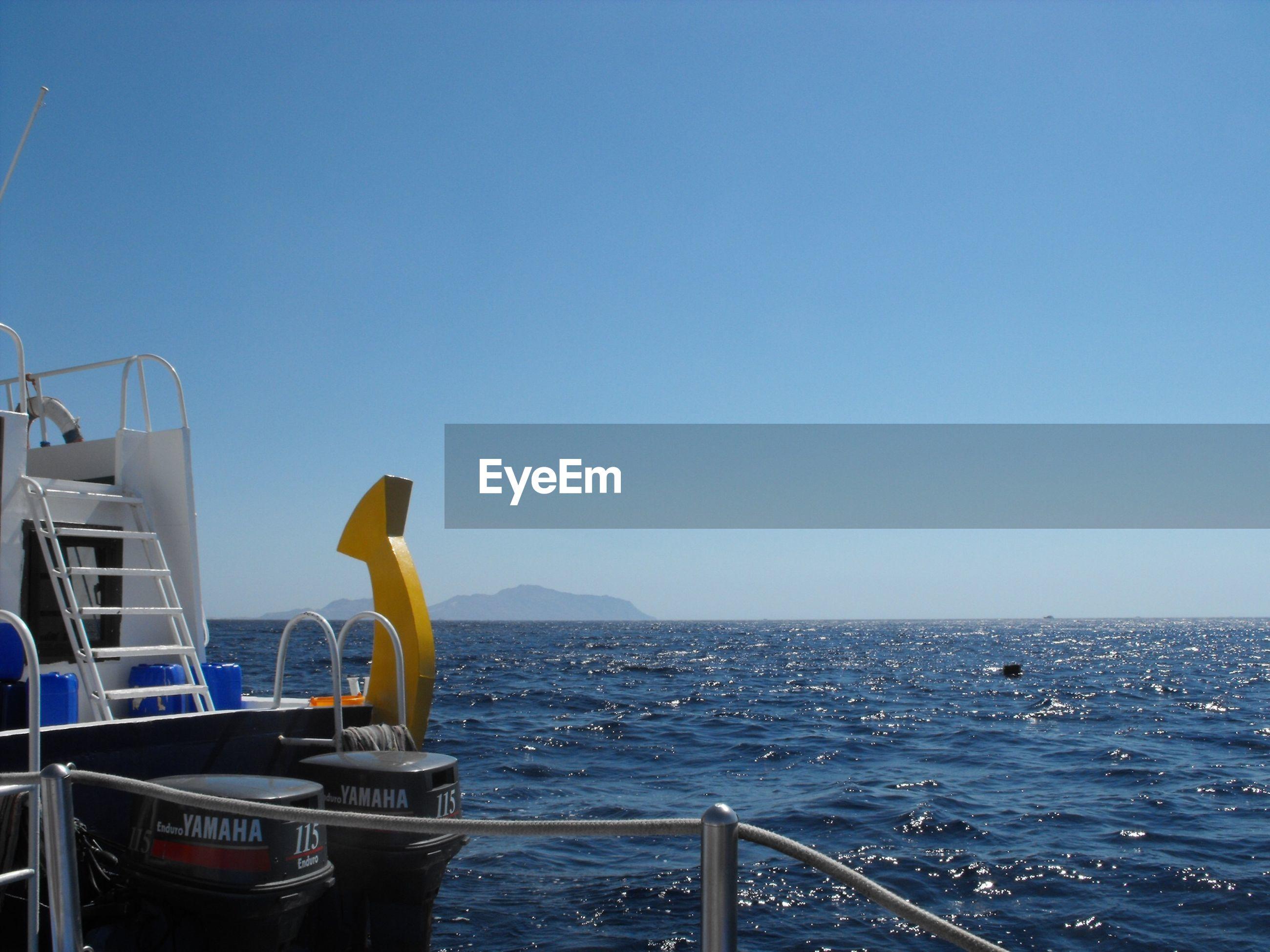 NAUTICAL VESSEL ON SEA AGAINST CLEAR BLUE SKY