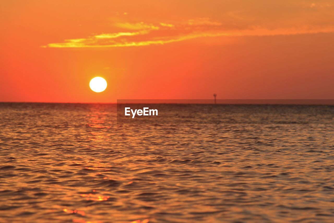 sunset, orange color, sea, sun, beauty in nature, scenics, nature, tranquility, horizon over water, tranquil scene, sky, idyllic, water, outdoors, no people, moon