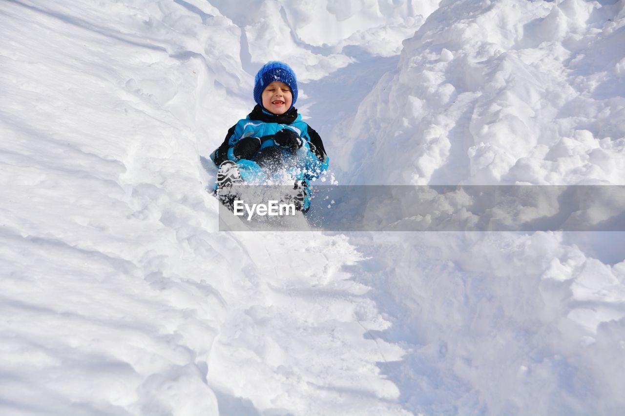 Full Length Of Boy In Snow