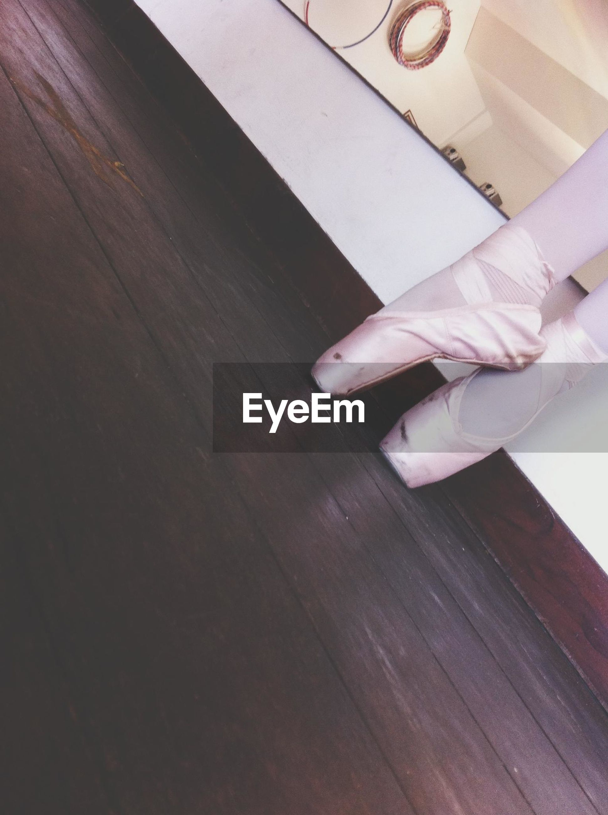 indoors, part of, wood - material, high angle view, cropped, person, still life, table, close-up, wooden, low section, flooring, hardwood floor, art and craft, work tool, shoe, paper