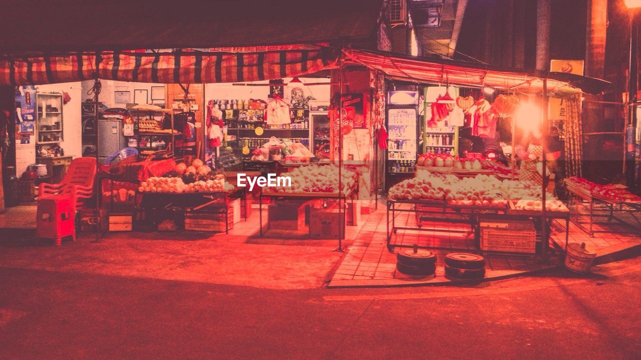 retail, for sale, market, market stall, small business, night, store, illuminated, outdoors, food, large group of objects, food and drink, choice, architecture, built structure, consumerism, red, real people, farmer market, price tag, building exterior, freshness, city