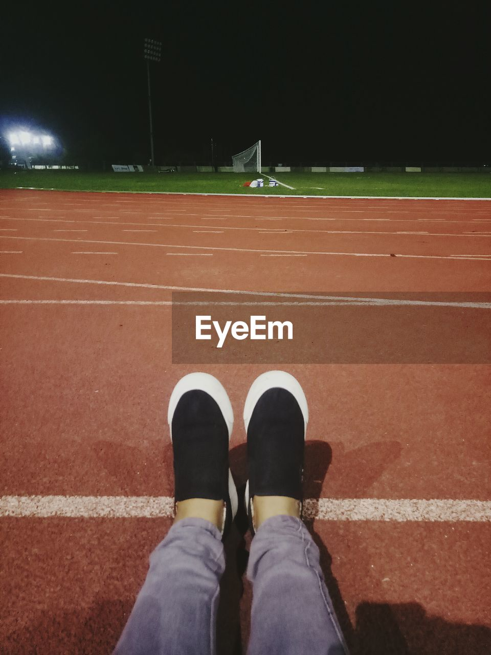 sport, real people, low section, one person, shoe, human leg, court, tennis, running track, high angle view, lifestyles, outdoors, leisure activity, standing, day, human body part, sports clothing