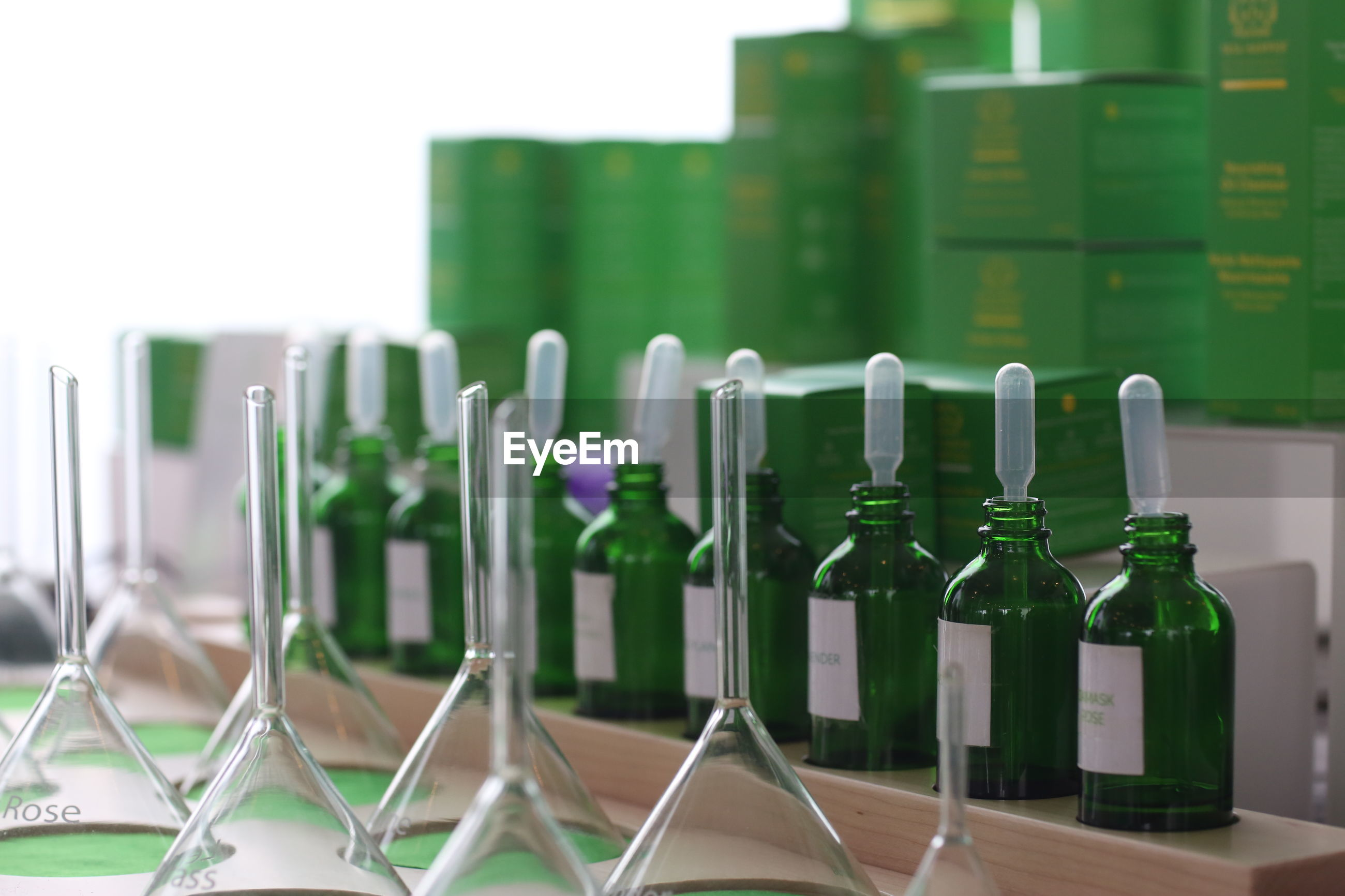 CLOSE-UP OF EMPTY GLASS BOTTLES IN SHELF
