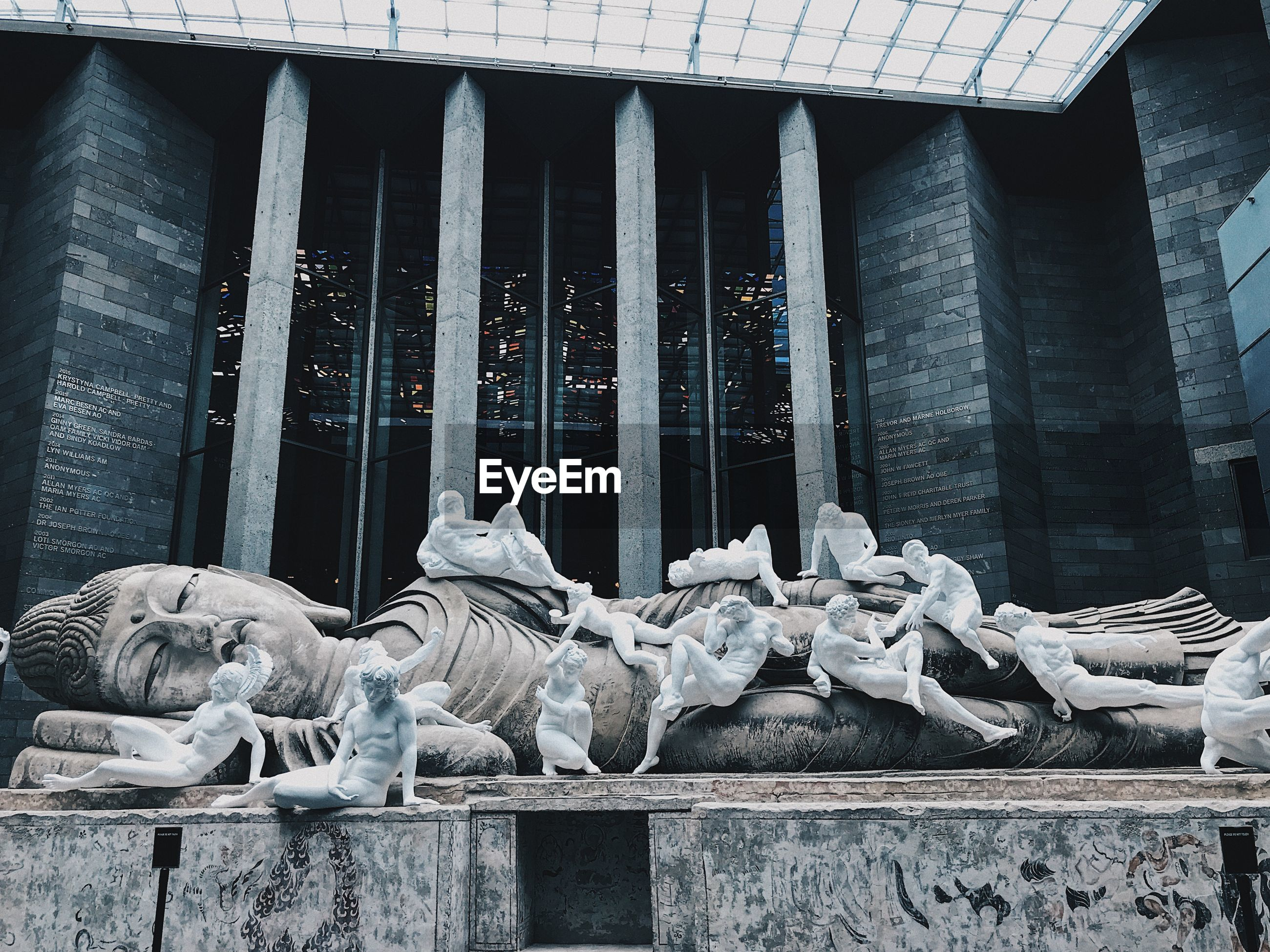 Statues against building in city