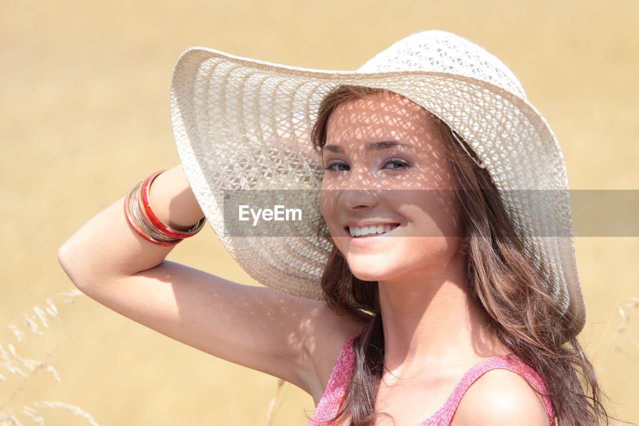 headshot, portrait, smiling, one person, real people, happiness, young adult, lifestyles, women, hat, adult, young women, leisure activity, focus on foreground, emotion, front view, looking at camera, clothing, beautiful woman, hairstyle