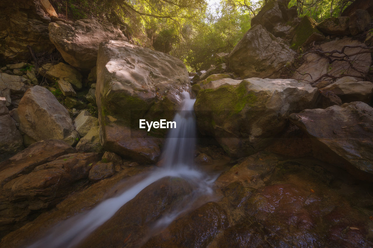 rock, water, long exposure, motion, beauty in nature, solid, rock - object, scenics - nature, waterfall, flowing water, no people, nature, tree, forest, blurred motion, land, day, environment, non-urban scene, outdoors, flowing, stream - flowing water, falling water, power in nature
