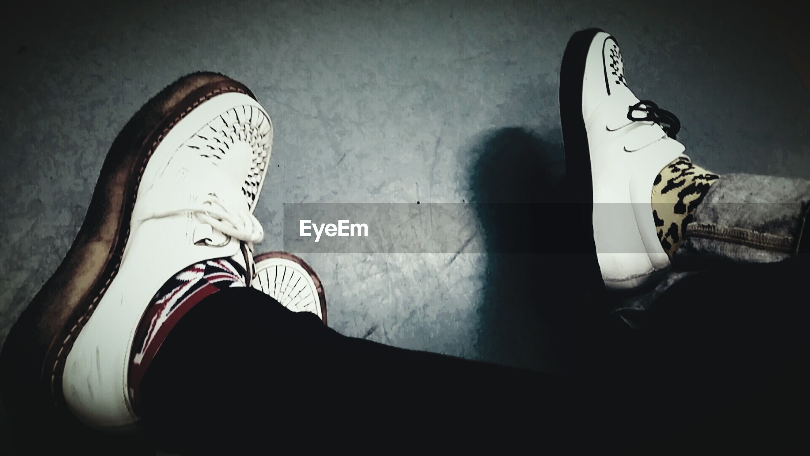 shoe, indoors, low section, person, footwear, jeans, standing, high angle view, fashion, pair, close-up, lifestyles, canvas shoe, human foot, personal perspective, flooring, floor