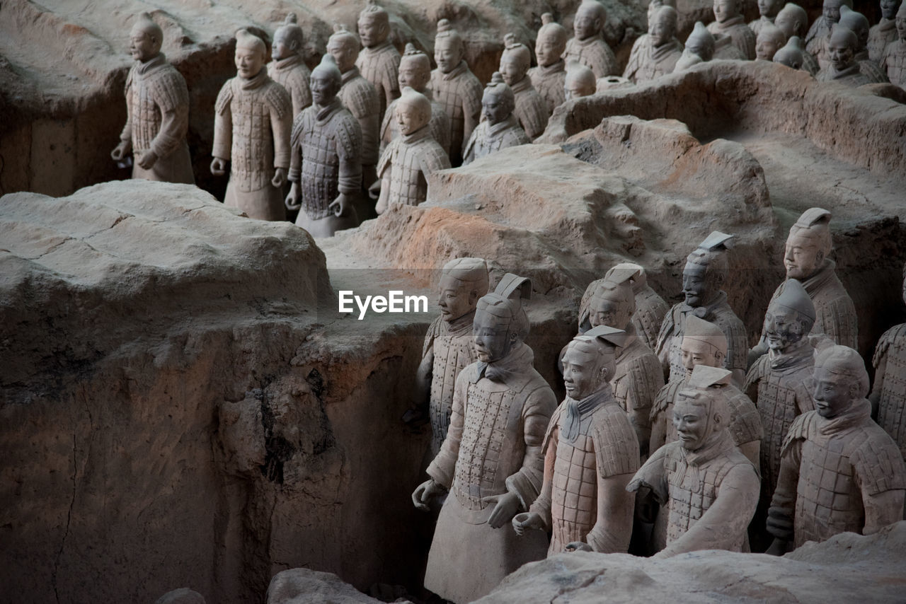 representation, human representation, male likeness, statue, sculpture, art and craft, creativity, no people, history, travel destinations, craft, solid, travel, tourism, the past, day, ancient, rock formation, architecture, low angle view, ancient civilization, carving, idol