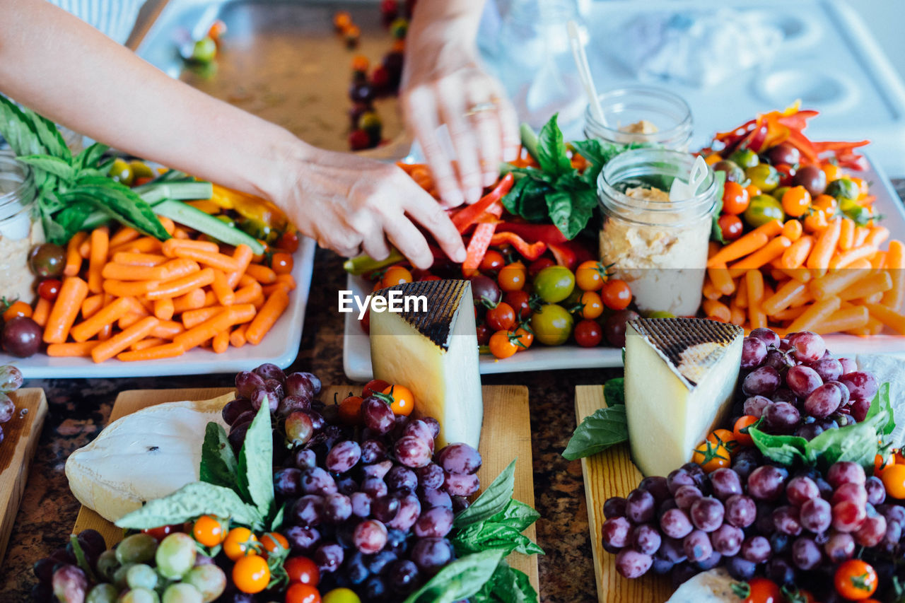 Cropped Image Of Person At Raw Food In Tray On Table