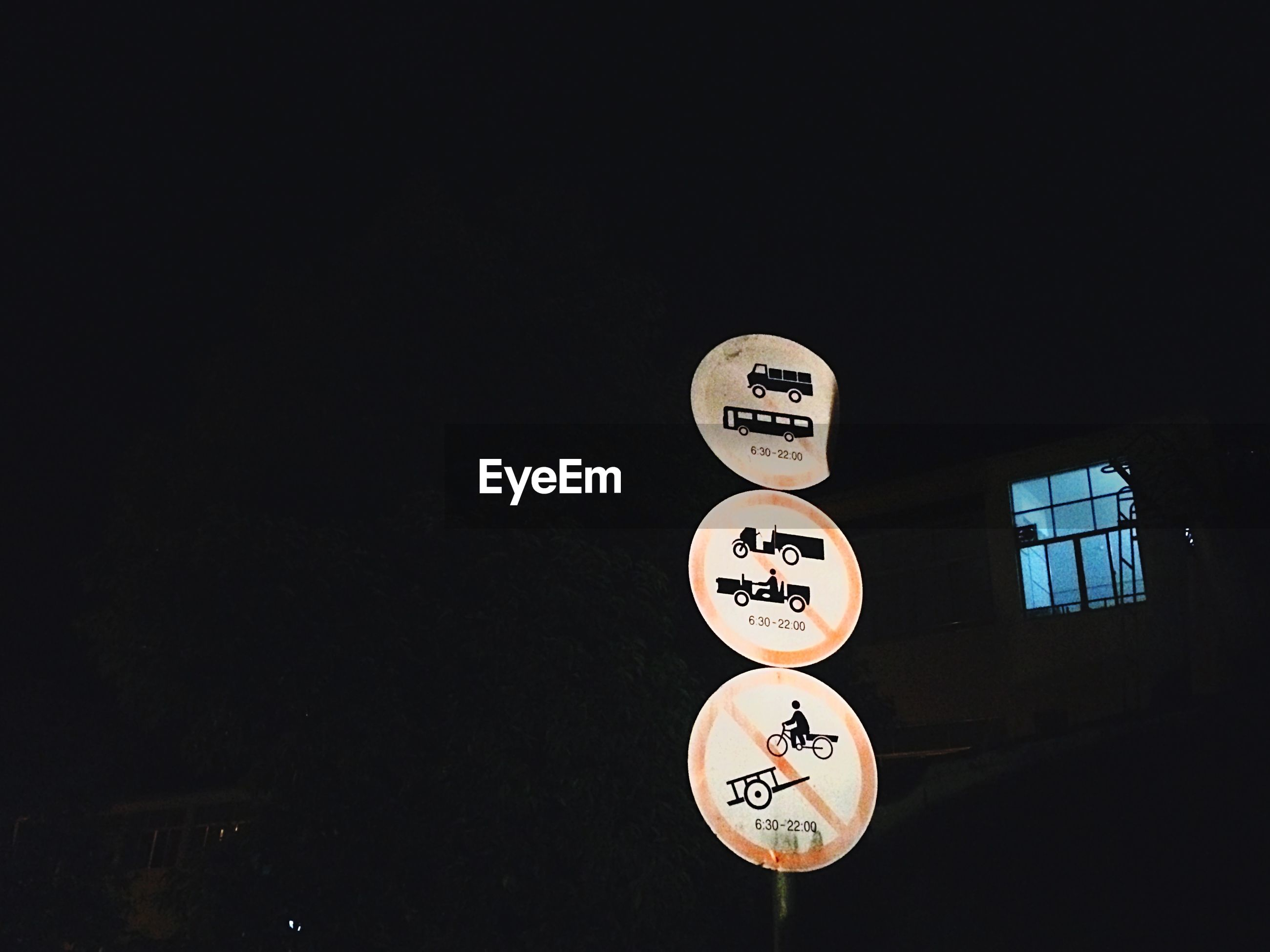 text, communication, western script, sign, information sign, information, capital letter, guidance, non-western script, copy space, illuminated, number, warning sign, clear sky, night, low angle view, road sign, no people, circle, arrow symbol