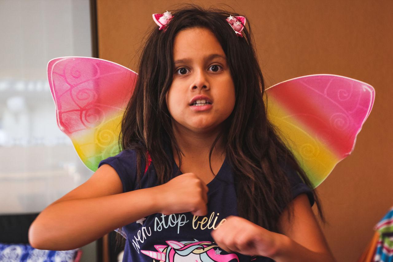 Portrait of cute girl in costume butterfly wings