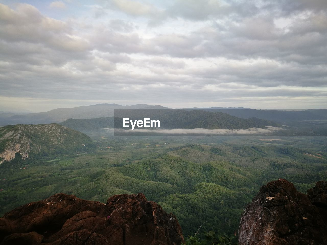 SCENIC VIEW OF MOUNTAIN RANGE AND CLOUDY SKY