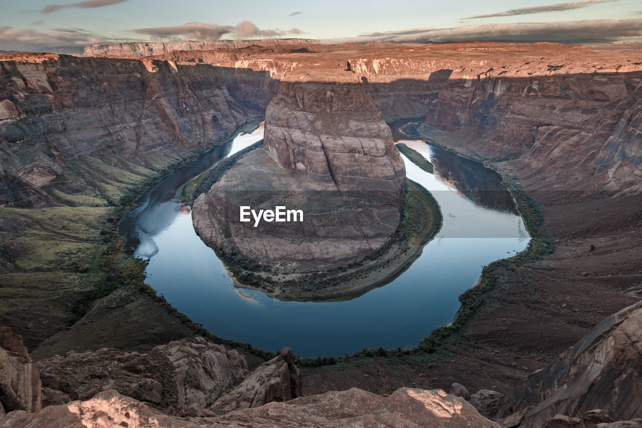 Scenic view of sunrise at horseshoe bend rock formation near page, arizona with river