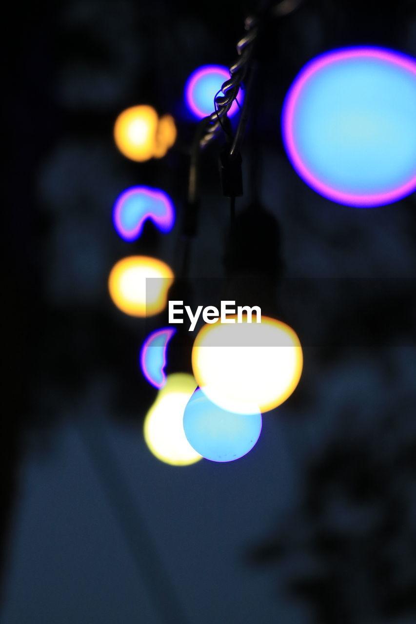 LOW ANGLE VIEW OF ILLUMINATED LIGHTS ON LIGHT