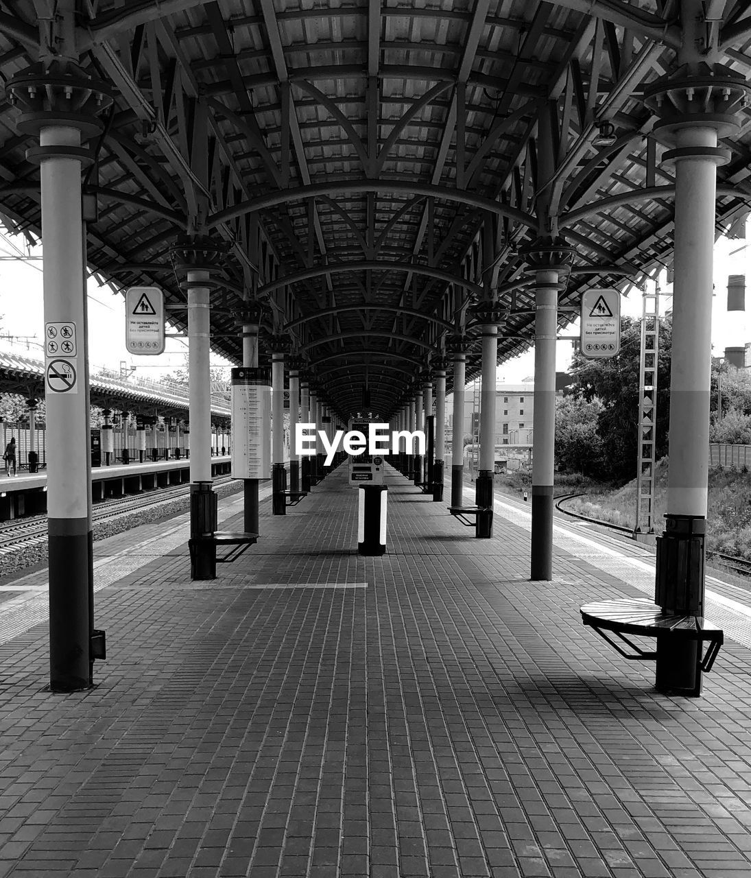 EMPTY RAILROAD STATION PLATFORM IN CITY