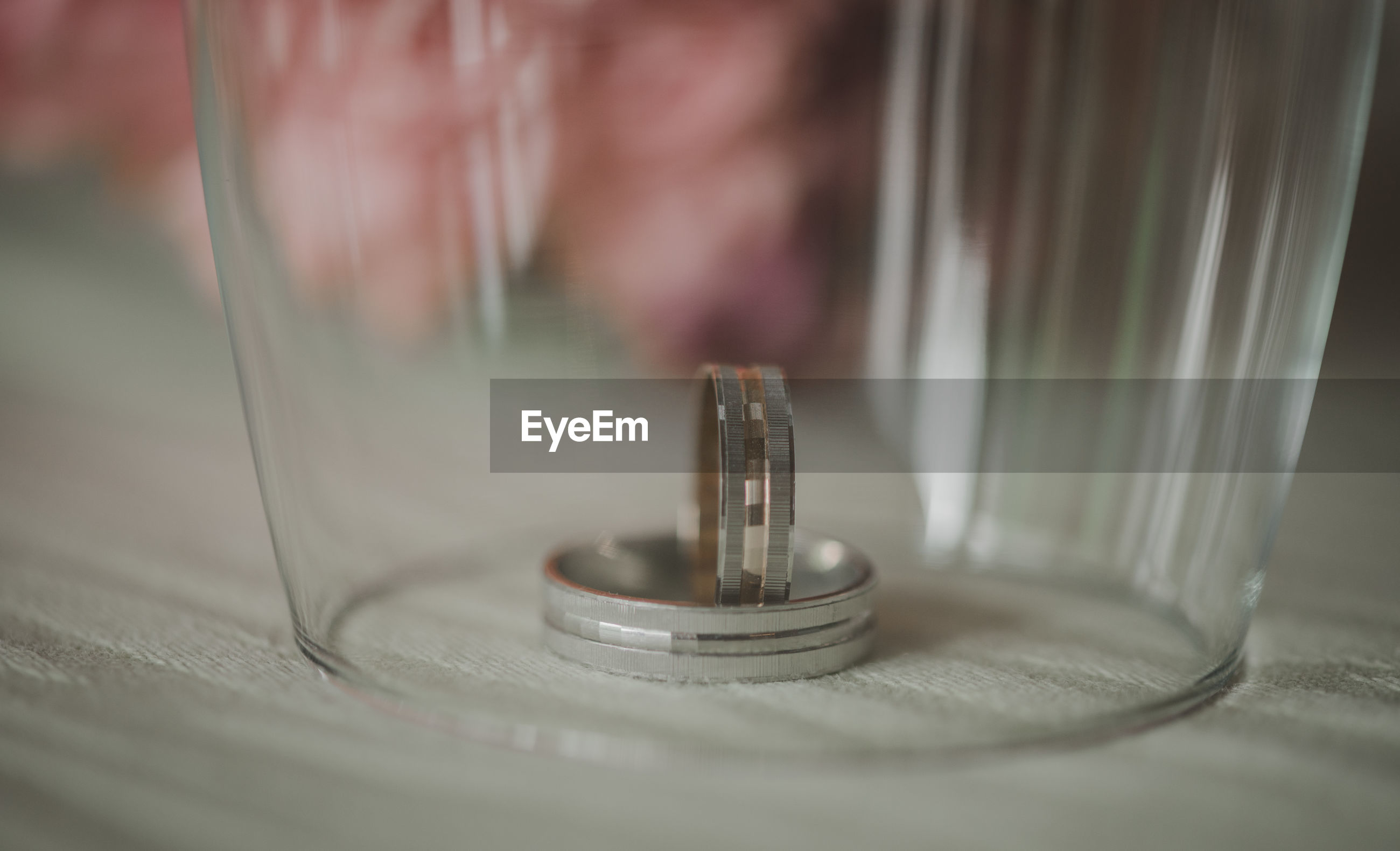 Close-up of wedding rings in glass