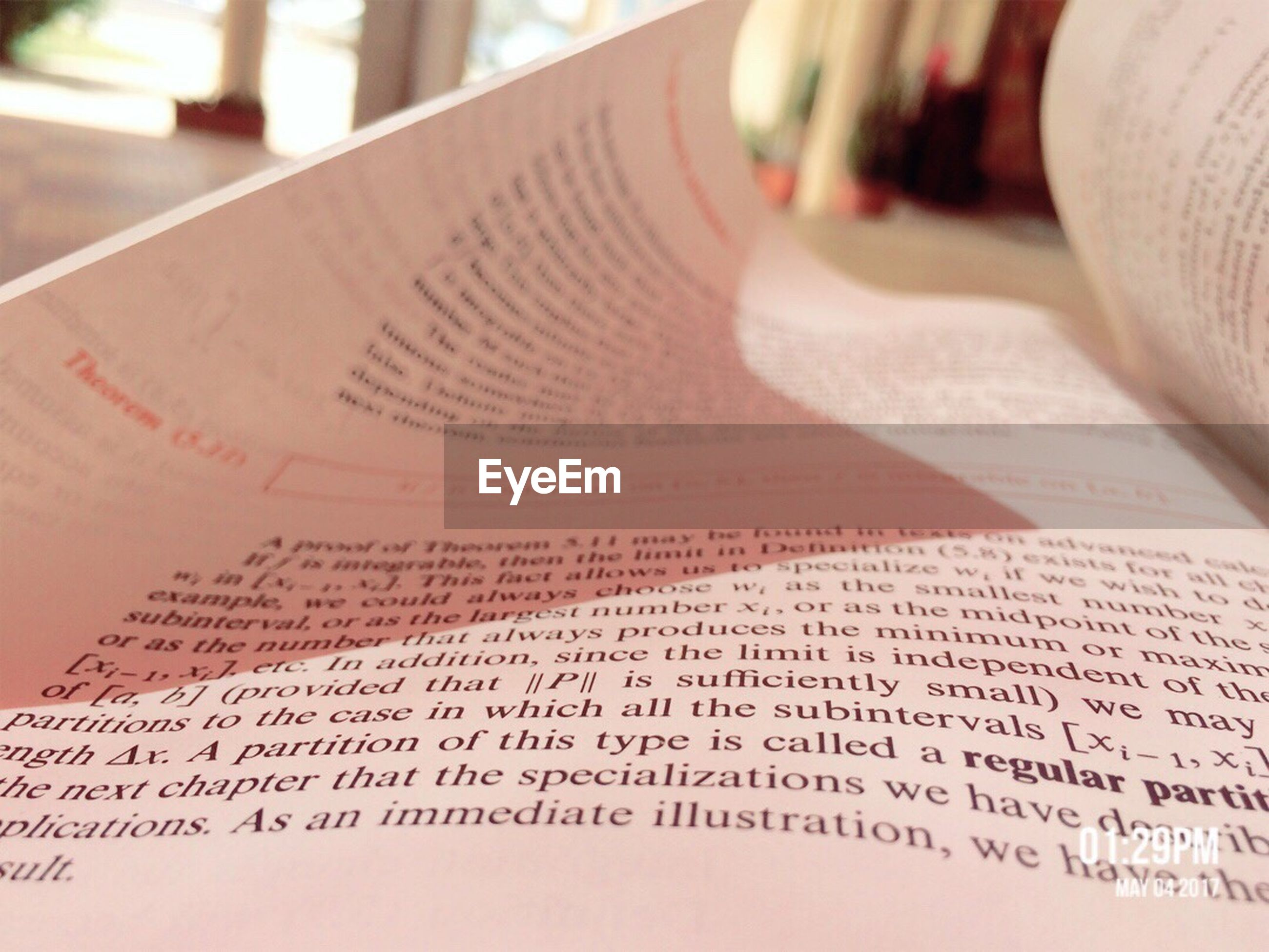 text, book, paper, communication, education, indoors, close-up, page, knowledge, table, focus on foreground, no people, literature, day