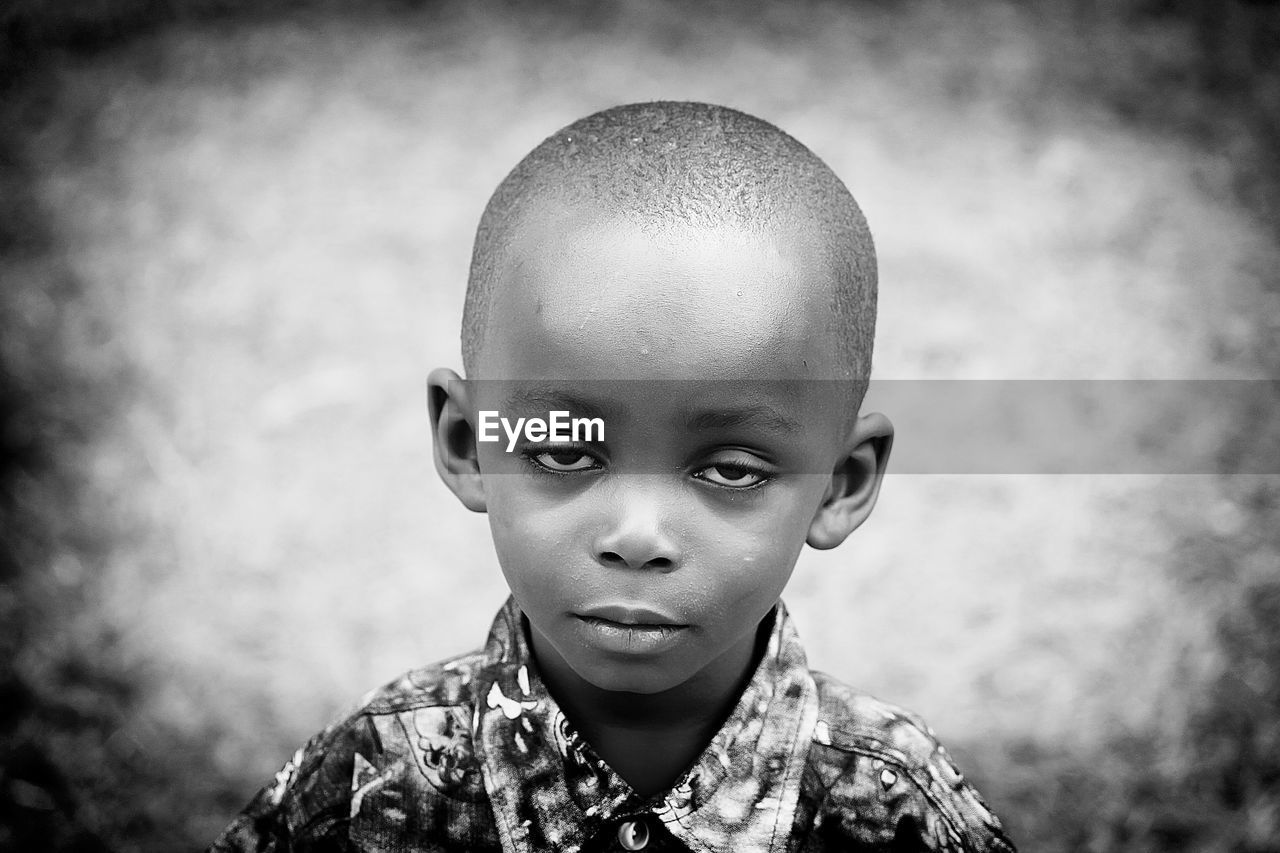 childhood, focus on foreground, real people, boys, elementary age, one person, front view, looking at camera, portrait, headshot, outdoors, lifestyles, close-up, day, one boy only, people