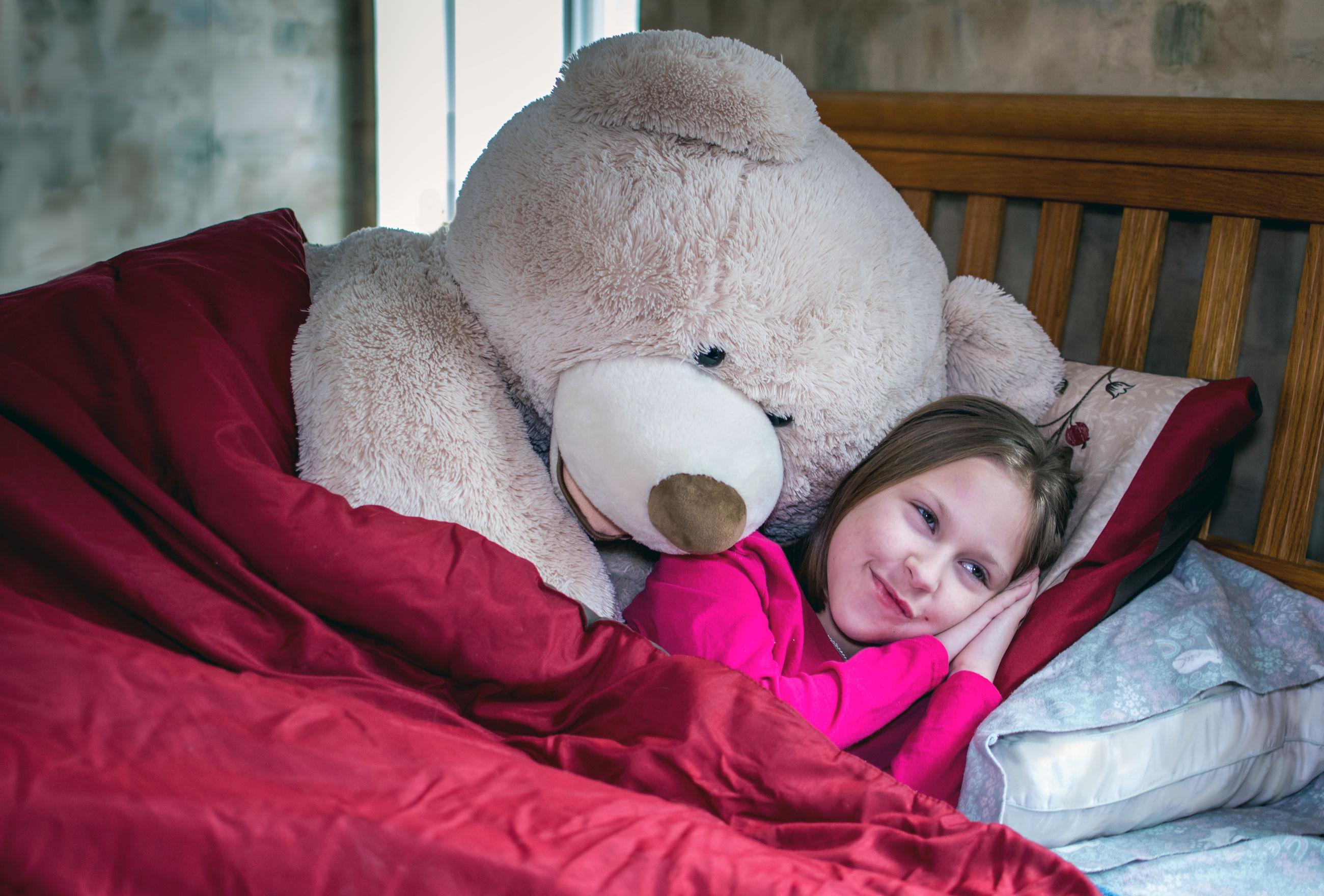 Big stuffed bear asks a little girl if she is awake or sleeping