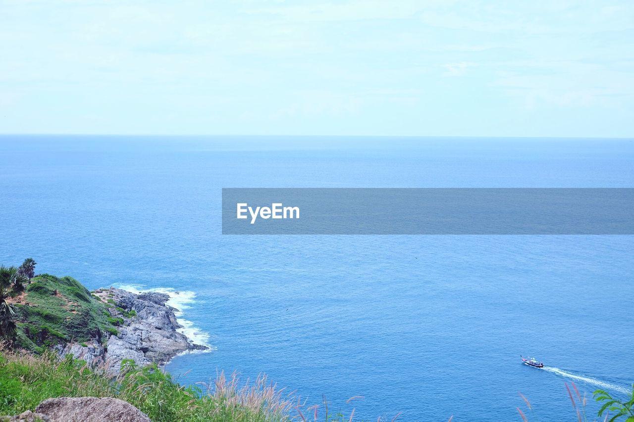 sea, water, scenics - nature, horizon over water, beauty in nature, horizon, sky, tranquil scene, tranquility, blue, idyllic, day, nature, non-urban scene, no people, high angle view, seascape, land, remote