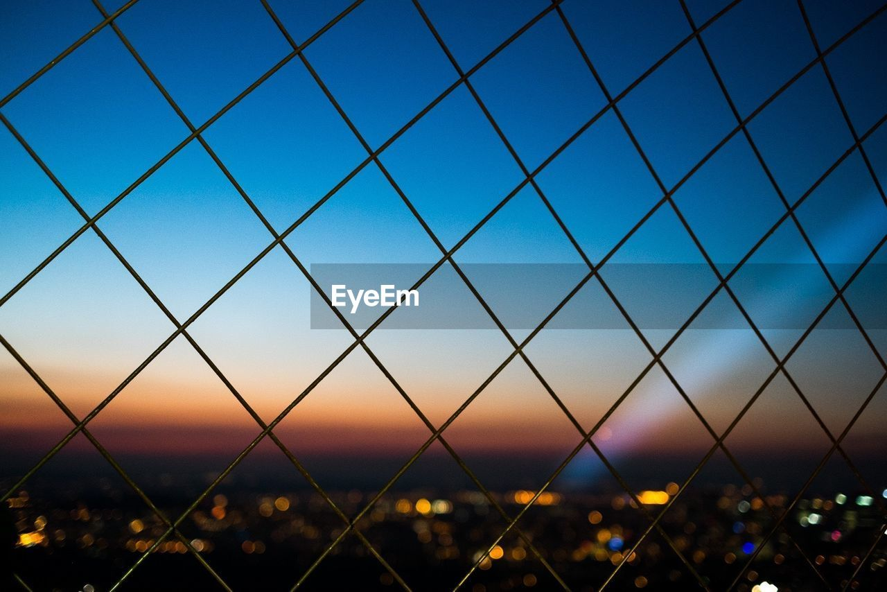 sky, fence, barrier, pattern, backgrounds, boundary, nature, chainlink fence, sunset, security, no people, protection, land, safety, dusk, metal, field, outdoors, blue, full frame