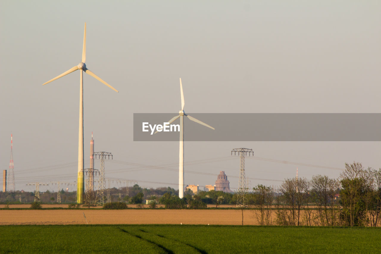 wind turbine, environmental conservation, fuel and power generation, wind power, alternative energy, renewable energy, windmill, field, industrial windmill, no people, day, nature, grass, outdoors, tree, sky